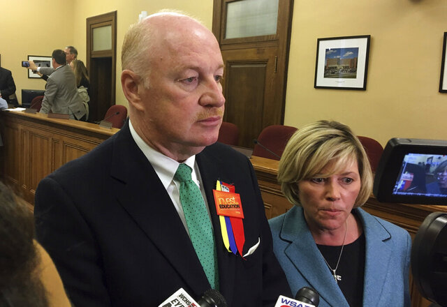 West Virginia Education Association President Dale Lee, left, and American Federation of Teachers' West Virginia chapter President Christine Campbell talk to reporters Tuesday, March 6, 2018, at the Capitol in Charleston, W.Va. The West Virginia Education Association filed a court challenge Monday, Oct. 5, 2020, to the state's color-coded map that determines whether counties can hold in-person public school classes during the coronavirus pandemic. The union wants to replace the school reentry map that has undergone multiple changes by Republican Gov. Jim Justice and state officials with one compiled by independent health experts. (AP Photo/John Raby)