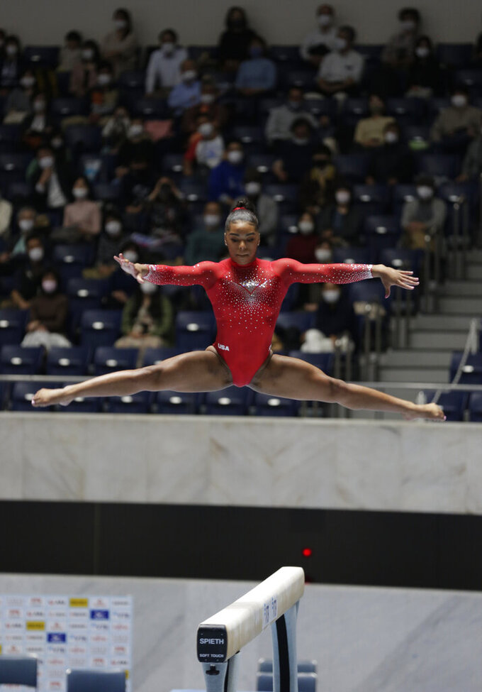eMjae Frazier of the U.S. competes in a balance beam event of an international gymnastics meet in Tokyo on Sunday, Nov. 8, 2020. Gymnasts from four countries of China, Russia, U.S. and Japan performed in the meet at Yoyogi National Stadium First Gymnasium, a venue planned to be used in the Tokyo 2020 Olympics in the summer 2021. (AP Photo/Hiro Komae)