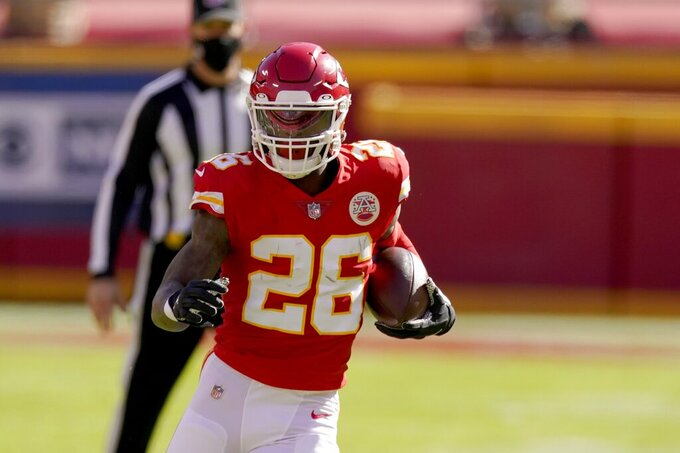 Kansas City Chiefs running back Le'Veon Bell (26) carries the ball against the New York Jets in the first half of an NFL football game on Sunday, Nov. 1, 2020, in Kansas City, Mo. (AP Photo/Charlie Riedel)