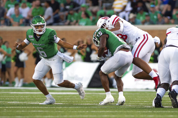 North Texas quarterback Mason Fine (6) passes to running back Tre Siggers (15) during the first half of an NCAA college game against Houston on Saturday, Sept. 28, 2019, in Denton, Texas.  (Kara Dry/The Denton Record-Chronicle via AP)