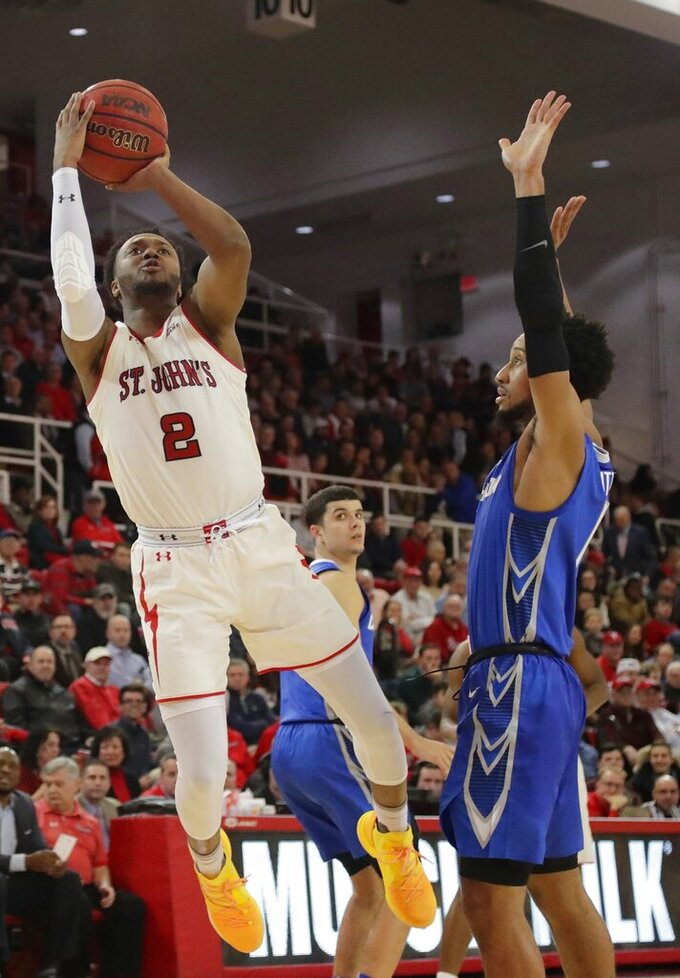 St. John's Shamorie Ponds (2) drives past Creighton's Davion Mintz (1) during the second half of an NCAA college basketball game Wednesday, Jan. 16, 2019, in New York. (AP Photo/Frank Franklin II)