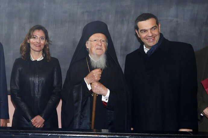 Greece's Prime Minister Alexis Tsipras, right, his partner Betty Baziana, left, and Ecumenical Patriarch Bartholomew I pose for the photographers during their visit at the Theological School of Halki, in Heybeli Island, near Istanbul, Wednesday, Feb. 6, 2019. The president of Turkey and the prime minister of Greece agreed Tuesday on the need to keep