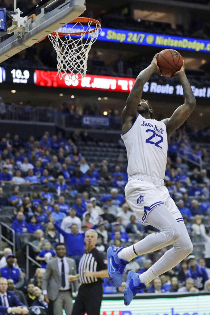 Seton Hall's Myles Cale spins in the air before dunking during the second half of an NCAA college basketball game against St. John's in Newark, N.J., Sunday, Feb. 23, 2020. Seton Hall defeated St. John's 81-65. (AP Photo/Seth Wenig)
