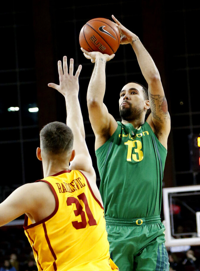 Oregon's Paul White, right, shoots against Southern California's Nick Rakocevic during the first half of an NCAA college basketball game Thursday, Feb. 21, 2019, in Los Angeles. (AP Photo/Ringo H.W. Chiu)
