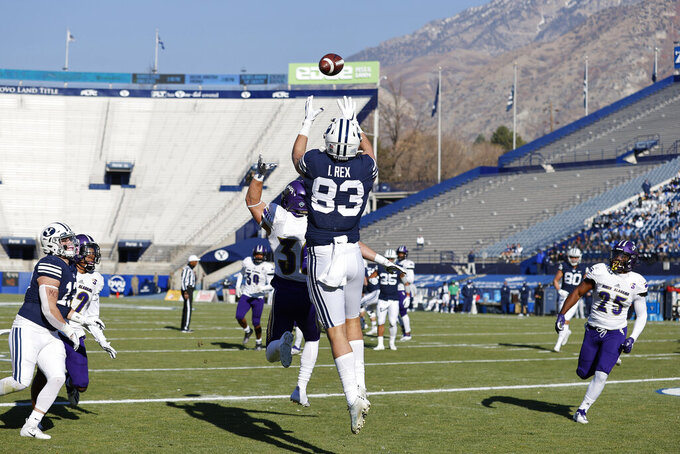 BYU tight end Isaac Rex (83) makes a reception for a touchdown over North Alabama linebacker Jakob Cummings (36) in the first quarter during an NCAA college football game Saturday, Nov. 21, 2020, in Provo, Utah. (AP Photo/Jeff Swinger, Pool)