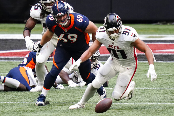 Atlanta Falcons defensive tackle Jacob Tuioti-Mariner (91) prepares to recover a fumble against the Denver Broncos during the second half of an NFL football game, Sunday, Nov. 8, 2020, in Atlanta. The Atlanta Falcons won 34-27. (AP Photo/Brynn Anderson)