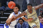 Pittsburgh's Justin Champagnie (11) and Georgia Tech's Moses Wright (5) chase after a loose ball during the first half of an NCAA college basketball game, Saturday, Feb. 8, 2020, in Pittsburgh. (AP Photo/Keith Srakocic)