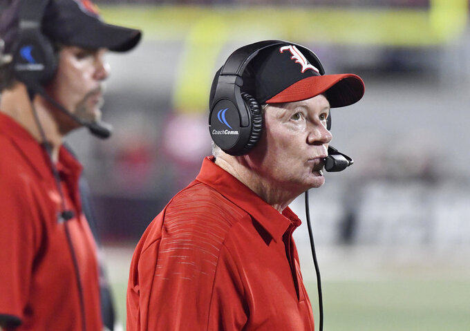FILE - In this Oct. 5, 2018, file photo, Louisville coach Bobby Petrino watches a replay on the video board during the second half of the team's NCAA college football game against Georgia Tech in Louisville, Ky. Georgia Tech won 66-31. The Cardinals (2-4) have lost three straight and are winless in Atlantic Coast Conference competition heading into Saturday's game at Boston College. (AP Photo/Timothy D. Easley, File)