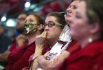 Florida State fans listen during the service for longtime Florida State football coach Bobby Bowden, as he lies in repose at the Tucker Civic Center during a public celebration of life, Saturday, Aug. 14, 2021, in Tallahassee, Fla. Bowden became the FSU football coach in 1976, transforming the program into one of the best in the country. He coached FSU to national championships in 1993 and 1999. Bowden was 91. (AP Photo/Mark Wallheiser)