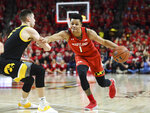 Maryland guard Anthony Cowan Jr. (1) drives to the basket against Iowa guard CJ Fredrick (5) during the second half of an NCAA college basketball game Thursday, Jan. 30, 2020, in College Park, Md. (AP Photo/Terrance Williams)