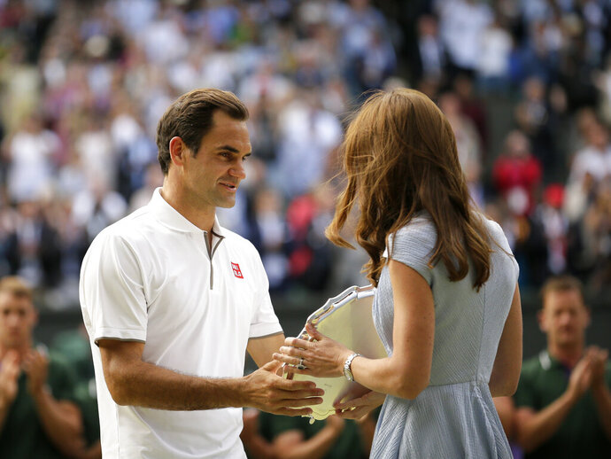 Switzerland's Roger Federer receives the runner up trophy from Kate, Duchess of Cambridge after losing to Serbia's Novak Djokovic in the men's singles final match of the Wimbledon Tennis Championships in London, Sunday, July 14, 2019. (AP Photo/Tim Ireland)