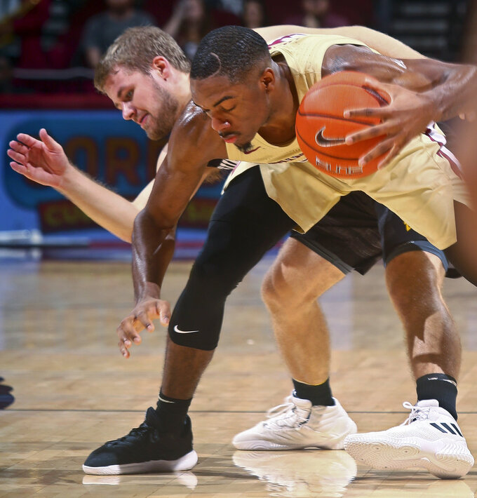 Winthrop guard Bjorn Broman, left, fouls Florida State guard Trent Forrest (3) during the second half of an NCAA college basketball game in Tallahassee, Fla., Tuesday, Jan. 1, 2019. Florida State won 87-76. (AP Photo/Phil Sears)