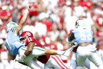 Oklahoma linebacker Nik Bonitto (11) hits Tulane quarterback Michael Pratt (7) during NCAA college football game in Norman, Okla. on Saturday, Sept. 4, 2021. (Ian Maule/Tulsa World via AP)
