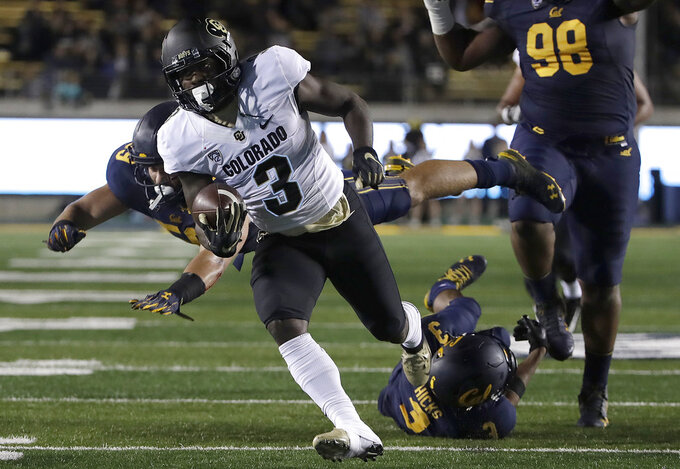Colorado wide receiver K.D. Nixon (3) runs past a diving California linebacker Jordan Kunaszyk, defensive tackle Chris Palmer (98) and cornerback Elijah Hicks (3) to score during the second half of an NCAA college football game in Berkeley, Calif., Saturday, Nov. 24, 2018. (AP Photo/Jeff Chiu)