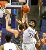 Washington's Isaiah Stewart blocks a shot by Eastern Washington's Jacob Groves, but is called for a foul during the first half of an NCAA college basketball game Wednesday, Dec. 4, 2019, in Seattle. (Dean Rutz/The Seattle Times via AP)