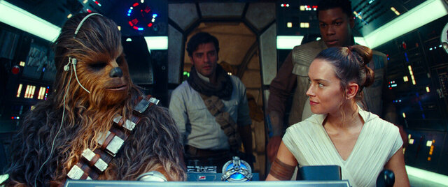This image released by Disney/Lucasfilm shows, from left,  Joonas Suotamo as Chewbacca, Oscar Isaac as Poe Dameron, Daisy Ridley as Rey and John Boyega as Finn in a scene from