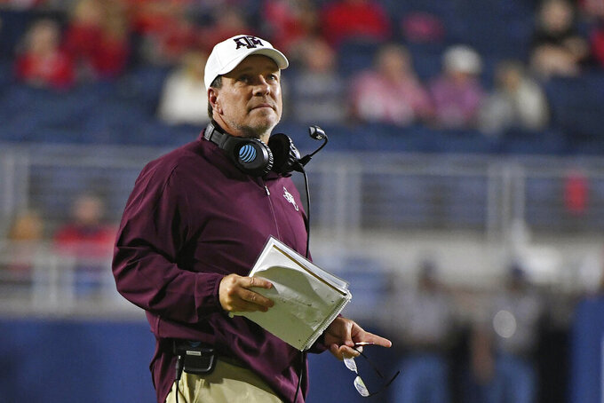 FILE - Texas A&M head coach Jimbo Fisher watches during the first half of an NCAA college football game against Mississippi in Oxford, Miss., Saturday, Oct. 19, 2019. As Jimbo Fisher enters his third season at Texas A&M he has a luxury afforded to very few coaches: a four-year starter at quarterback in Kellen Mond. (AP Photo/Thomas Graning, File)