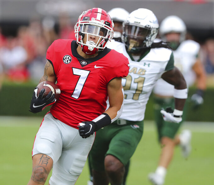 Georgia wide receiver Jermaine Burton catches a pass from Stetson Bennett for a touchdown on the opening drive against UAB during the first quarter of an NCAA college football game, Saturday, Sept. 11, 2021, in Athens, Ga. (Curtis Compton/Atlanta Journal-Constitution via AP)