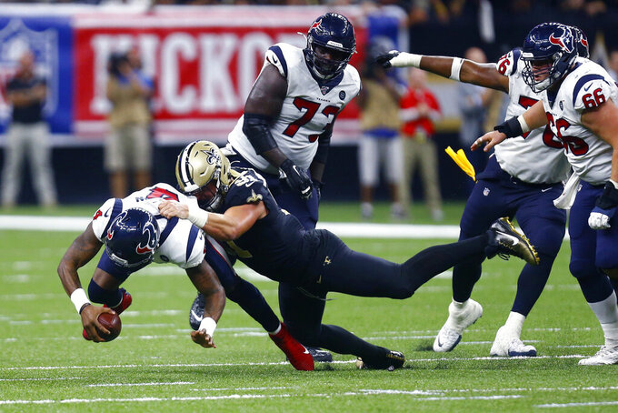 New Orleans Saints defensive end Trey Hendrickson (91) sacks Houston Texans quarterback Deshaun Watson (4) in the second half of an NFL football game in New Orleans, Monday, Sept. 9, 2019. (AP Photo/Butch Dill)