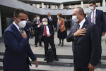Turkey's Foreign Minister Mevlut Cavusoglu, right, and Italy's Foreign Minister Luigi Di Maio gesture as they say goodbye after their joint press conference, in Ankara, Turkey, Friday, June 19, 2020.(Fatih Aktas/Turkish Foreign Ministry via AP, Pool)