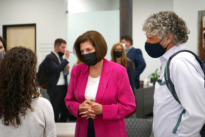 Sen. Catherine Cortez Masto, D-Nev., center, meets with people after speaking about the infrastructure bill at the Reno-Sparks Chamber of Commerce in Reno, Nev., Monday Aug. 23, 2021. Cortez Masto said infrastructure investments, tax credits for renewable energy projects and incentives to site solar and wind projects on former mines, would create jobs and protect the environment for future generations.  (AP Photo/Samuel Metz.)
