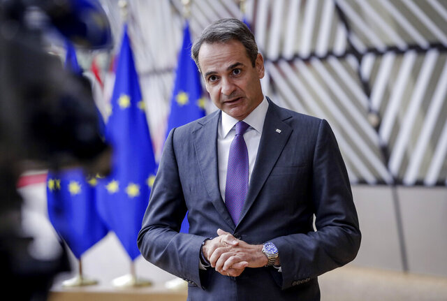 Greek Prime Minister Kyriakos Mitsotakis arrives for an EU summit at the European Council building in Brussels, Thursday, Oct. 15, 2020. European Union leaders are meeting in person for a two-day summit amid the worsening coronavirus pandemic to discuss topics ranging from Brexit to climate and relations with Africa. (Olivier Hoslet, Pool via AP)