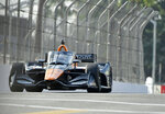 Indycar driver Pato O'Ward, from Mexico, races up Pine Avenue during the final practice session for the Grand Prix of Long Beach auto race Saturday, Sept. 25, 2021, in Long Beach, Calif. (Will Lester/The Orange County Register via AP)