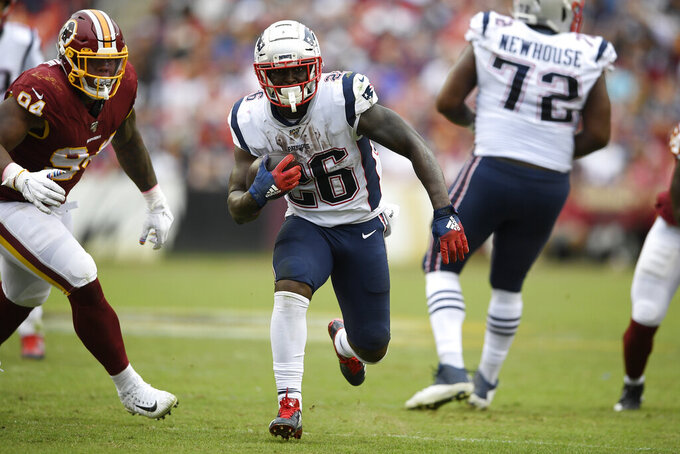 New England Patriots running back Sony Michel (26)during the second half of an NFL football game runs against the Washington Redskins, Sunday, Oct. 6, 2019, in Landover, Md. (AP Photo/Nick Wass)