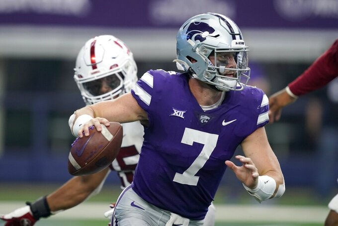 Kansas State quarterback Skylar Thompson (7) scrambles out of the pocket under pressure from Stanford in the second half of an NCAA college football game in Arlington, Texas, Saturday, Sept. 4, 2021. (AP Photo/Tony Gutierrez)