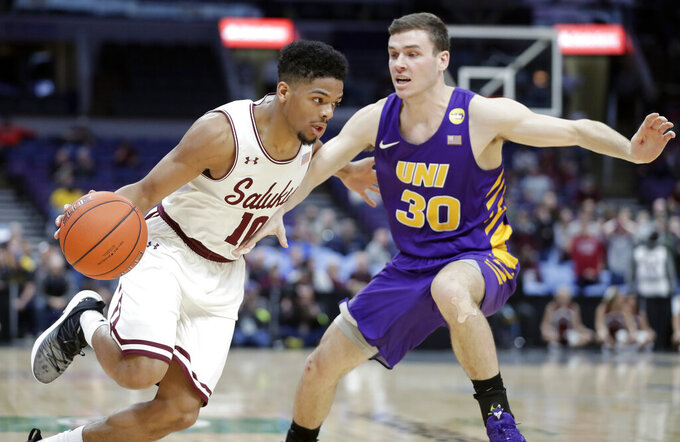 Southern Illinois' Aaron Cook, left, heads to the basket past Northern Iowa's Spencer Haldeman during the first half of an NCAA college basketball game in the quarterfinals of the Missouri Valley Conference men's tournament Friday, March 8, 2019, in St. Louis. (AP Photo/Jeff Roberson)