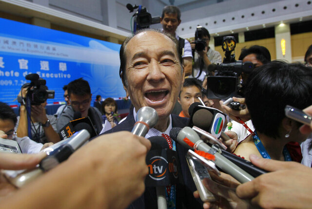 FILE : In this file photo taken on July 26, 2009, Macao tycoon Stanley Ho, talks to reporters after the Macau chief executive election in Macao. On Tuesday, May 26, 2020, the family of Stanley Ho, the Macao casino tycoon considered the father of modern gambling in China, has died at 98. (AP Photo/Vincent Yu, File)