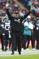 Jacksonville Jaguars head coach Doug Marrone walks the sidelines during the first half of an NFL football game against the Houston Texans at Wembley Stadium, Sunday, Nov. 3, 2019, in London. (AP Photo/Ian Walton)