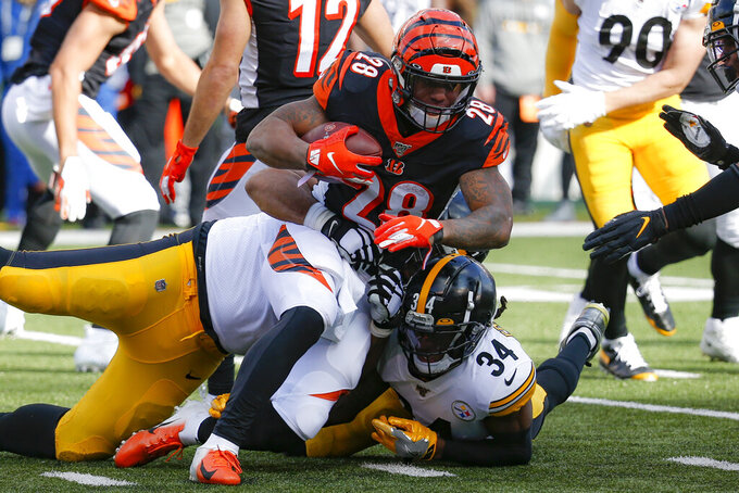 Cincinnati Bengals running back Joe Mixon (28) is tackled by Pittsburgh Steelers strong safety Terrell Edmunds (34) during the first half an NFL football game, Sunday, Nov. 24, 2019, in Cincinnati. (AP Photo/Frank Victores)