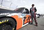 Brett Moffitt (23) next to his race car before a NASCAR Truck Series race at Dover International Speedway, Friday, Aug. 21, 2020, in Dover, Del. (AP Photo/Jason Minto)