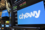 The logo for Chewy appears above trading posts on the floor of the New York Stock Exchange, Friday, June 14, 2019. Chewy, the online seller of pet food and squeaky toys, went public Friday and its shares soared 71%. (AP Photo/Richard Drew)