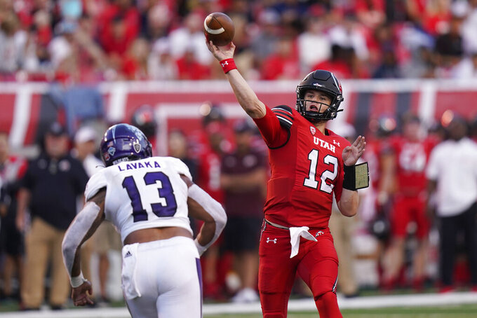 Utah quarterback Charlie Brewer (12) throws a pass as Weber State linebacker Sherwin Lavaka (13) defends during the first half of an NCAA college football game Thursday, Sept. 2, 2021, in Salt Lake City. (AP Photo/Rick Bowmer)