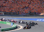 Red Bull driver Max Verstappen of the Netherlands leads at the start and followed by Mercedes driver Lewis Hamilton of Britain and Mercedes driver Valtteri Bottas of Finland during the Formula One Dutch Grand Prix, at the Zandvoort racetrack, Netherlands, Sunday, Sept. 5, 2021. (AP Photo/Peter Dejong)