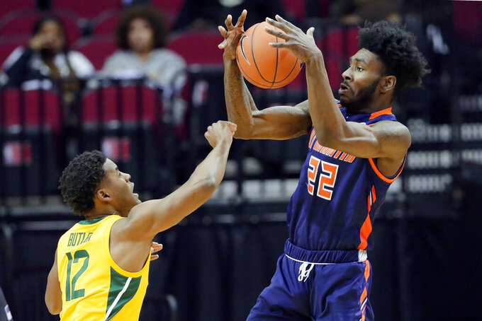 Tennessee-Martin forward Quintin Dove (22) pulls in a rebound over Baylor guard Jared Butler (12) during the first half of an NCAA college basketball game Wednesday, Dec. 18, 2019, in Houston. (AP Photo/Michael Wyke)
