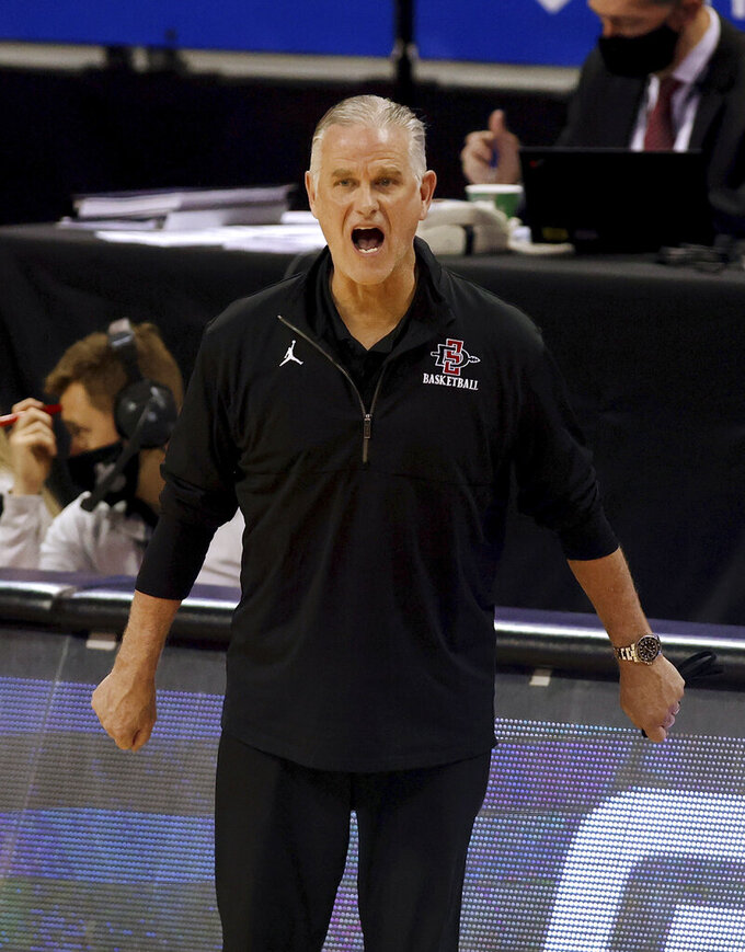 San Diego State coach Brian Dutcher shouts during the second half of the team's NCAA college basketball game against Nevada in the semifinals of the Mountain West Conference men's tournament Friday, March 12, 2021, in Las Vegas. (AP Photo/Isaac Brekken)