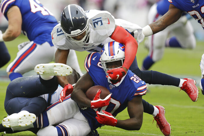 Buffalo Bills running back Frank Gore (20) is hit by Tennessee Titans free safety Kevin Byard (31) in the first half of an NFL football game Sunday, Oct. 6, 2019, in Nashville, Tenn. (AP Photo/James Kenney)