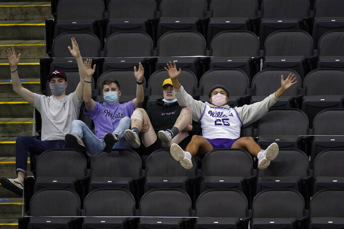 Kansas State fans cheer during the first half of the team's NCAA college basketball game against TCU in the first round of the Big 12 men's tournament in Kansas City, Mo., Wednesday, March 10, 2021. (AP Photo/Orlin Wagner)