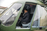 FILE - In this Oct. 9, 2019, file photo, Ukrainian Presidential Press Office, Ukrainian President Volodymyr Zelenskiy sits inside a military helicopter as he visits an arm exhibition in Kyiv, Ukraine. Ukraine may be at the center of a major geopolitical battle, but it's feeling increasingly alone and abandoned by its U.S. backers amid the impeachment drama unfolding in Washington. Facing that reality, Zelenskiy is reaching out to Russia directly in a bid to end the conflict before things get worse. (Ukrainian Presidential Press Office via AP, File)