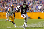 Mississippi State wide receiver Osirus Mitchell (5) carries on a touchdown reception as he is pursued by LSU cornerback Eli Ricks (1) in the first half an NCAA college football game in Baton Rouge, La., Saturday, Sept. 26, 2020. Mississippi State won 44-34. (AP Photo/Gerald Herbert)
