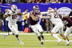 Texas A&M quarterback Kellen Mond (11) gets through the hole between Oklahoma State defensive end Tyler Lacy (89) and safety Malcolm Rodriguez (20) on the way to a touchdown during the second half of the Texas Bowl NCAA college football game Friday, Dec. 27, 2019, in Houston. (AP Photo/Michael Wyke)