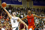 Michigan State forward Thomas Kithier (15) grabs a pass over Virginia Tech guard Landers Nolley II (2) during the first half of an NCAA college basketball game Monday, Nov. 25, 2019, in Lahaina, Hawaii. (AP Photo/Marco Garcia)