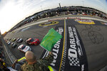 FILE - In this May 11, 2012, file photo, drivers take the green flag for the start of the NASCAR Nationwide Series auto race at Darlington Raceway in Darlington, S.C. NASCAR will re-fire the engines moments after mask-clad drivers climb into their cars at Darlington Raceway. The season will resume Sunday May 17, 2020, without spectators and drivers will have no practice before they pull away from pit road for the first time in more than two months. (Tyler Barrick/Pool Photo via AP, File)
