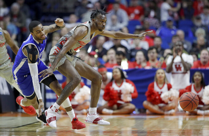 Houston's Dejon Jarreau, right, and Georgia State's Damon Wilson chase a loose ball during the first half of a first round men's college basketball game in the NCAA Tournament Friday, March 22, 2019, in Tulsa, Okla. (AP Photo/Charlie Riedel)