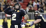 FILE - In this Dec. 27, 2017, file photo, Purdue quarterback Elijah Sindelar, left, throws against Arizona during the first half of the Foster Farms Bowl NCAA college football game in Santa Clara, Calif. Sindelar, set to take over for David Blaugh, put a scare into the Boilermakers when he hyperextended his left knee during spring football practice.  (AP Photo/Marcio Jose Sanchez, File)