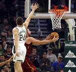 Milwaukee Bucks' Pat Connaughton (24) defends against Cleveland Cavaliers' Kevin Love during the first half of an NBA basketball game Monday, Oct. 28, 2019, in Milwaukee. (AP Photo/Jeffrey Phelps)