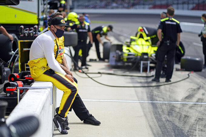 Scott McLaughlin, of New Zealand, watches as he sits on pit wall during practice for the Indianapolis 500 auto race at Indianapolis Motor Speedway, Thursday, May 20, 2021, in Indianapolis. (AP Photo/Darron Cummings)